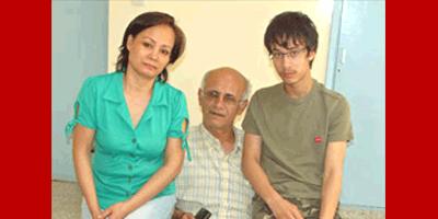 O cristão iraniano Mohammed Azbari, esposa e filho